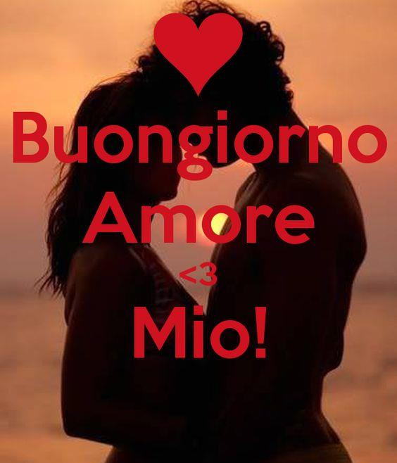 Una coppia che si bacia al tramonto con frase Buongiorno amore mio!