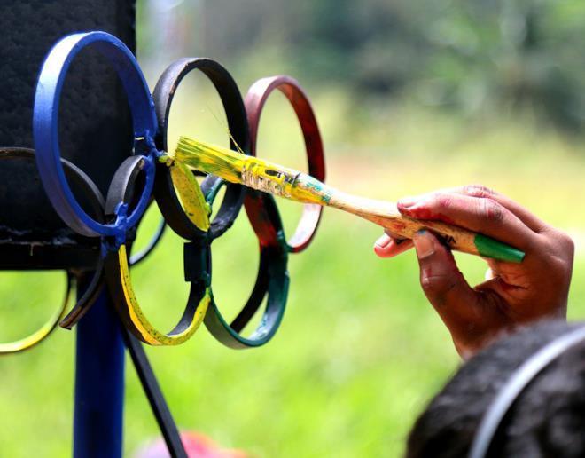 Copertina Olimpiadi frasi famose